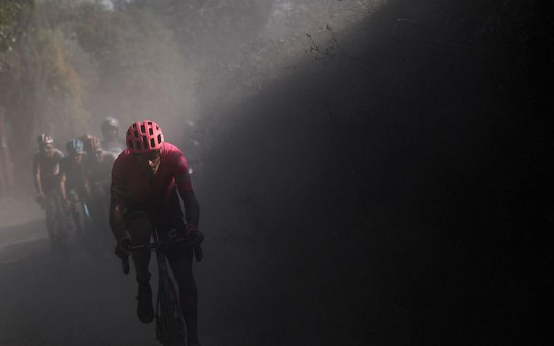 Team EF Pro Cycling Italian rider Alberto Bettiol pedal during a break away through a dusty gravel road in the oneday classic cycling race Strade Bianche White Roads on August 1 2020 around Siena Tuscany Photo by Marco Bertorello AFP Photo by MARCO BERTORELLOAFP via Getty Images