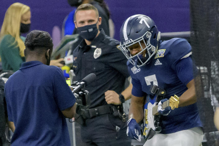 Georgia Southern wide receiver Khaleb Hood (7) celebrates with a guitar after scoring a touchdown against Louisiana Tech during the first half of the New Orleans Bowl NCAA college football game in New Orleans, Wednesday, Dec. 23, 2020. (AP Photo/Matthew Hinton)
