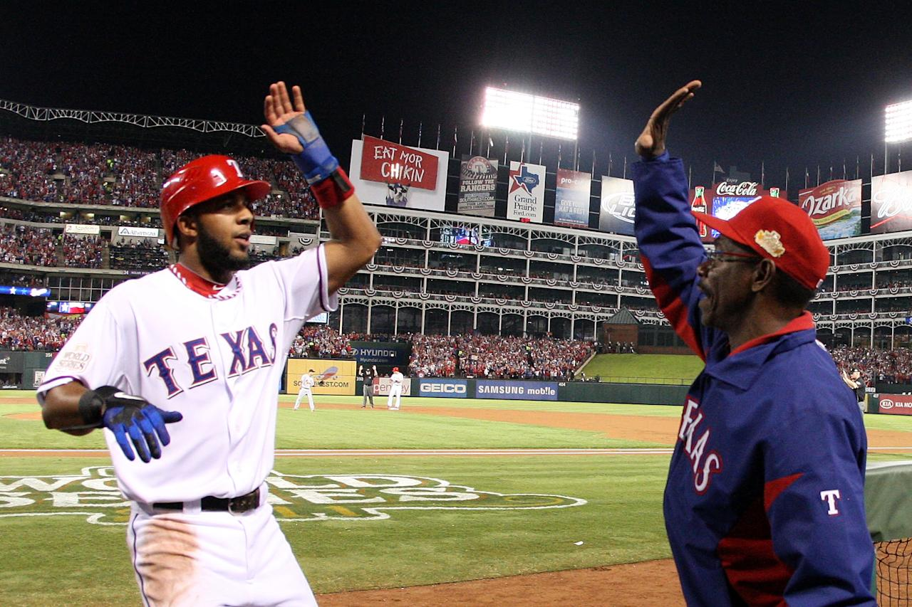 ARLINGTON, TX - OCTOBER 23:  Elvis Andrus #1 of the Texas Rangers celebrates with manager Ron Washington after scoring in the first inning during Game Four of the MLB World Series against the St. Louis Cardinals at Rangers Ballpark in Arlington on October 23, 2011 in Arlington, Texas.  (Photo by Tom Pennington/Getty Images)