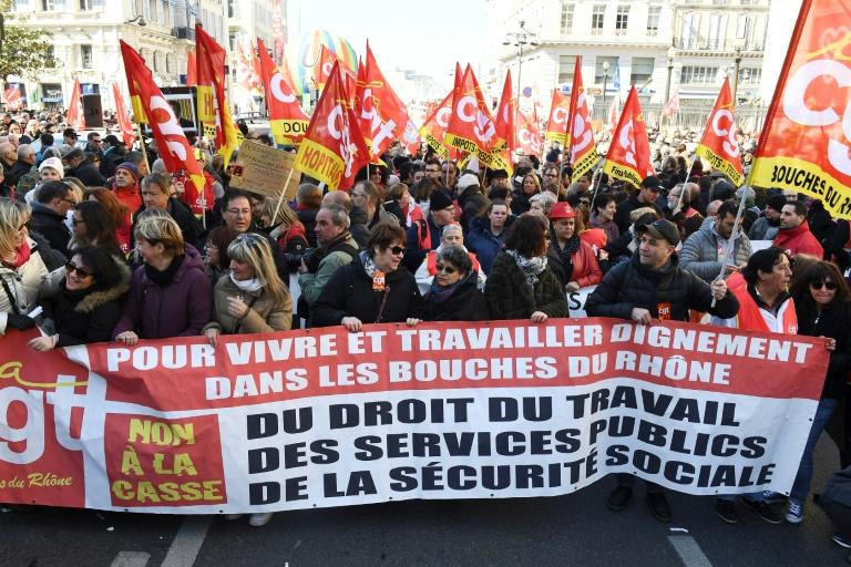 Union protesters at a demonstration in Marseille in southern France as a nationwide strike disrupts public services on Thursday