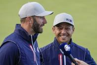 Team USA's Xander Schauffele and Team USA's Dustin Johnson smile after winning their four-ball match the Ryder Cup at the Whistling Straits Golf Course Friday, Sept. 24, 2021, in Sheboygan, Wis. (AP Photo/Ashley Landis)