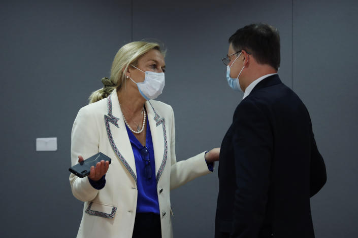 Netherlands' Foreign Trade Minister Sigrid Kaag, left, talks to European Commissioner for An Economy that Works for People Valdis Dombrovskis during a European Foreign Trade ministers meeting at the European Council headquarters in Brussels, Thursday, May 20, 2021. (AP Photo/Francisco Seco, Pool)