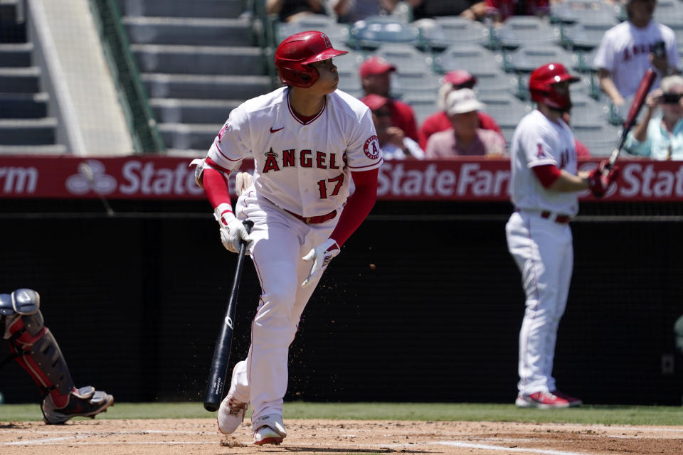 Los Angeles Angels' Shohei Ohtani runs to first as he hits a single during the first inning of a baseball game against the Boston Red Sox Wednesday, July 7, 2021, in Anaheim, Calif. (AP Photo/Mark J. Terrill)