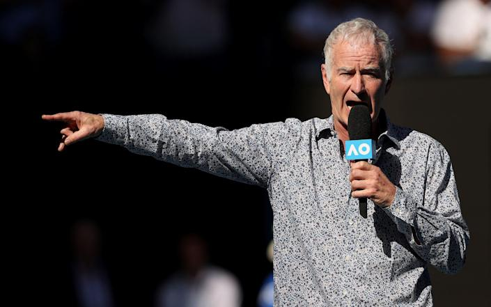 John McEnroe speaks on court after the Men's Singles third round match between Rafael Nadal of Spain and Pablo Carreno Busta of Spain - Getty Images