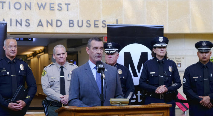 The Transportation Security Administration (TSA) administrator David P. Pekoske, center, talks during a news conference in Los Angeles' Union Station on Tuesday, Aug. 14, 2018. Pekoske talked about the ThruVision detection technology that reveals suspicious objects on people. Aiming to stay ahead of an evolving threat against transit systems worldwide, officials in Los Angeles are testing out the airport-style body scanners that screen subway passengers for firearms and explosives. (AP Photo/Richard Vogel)