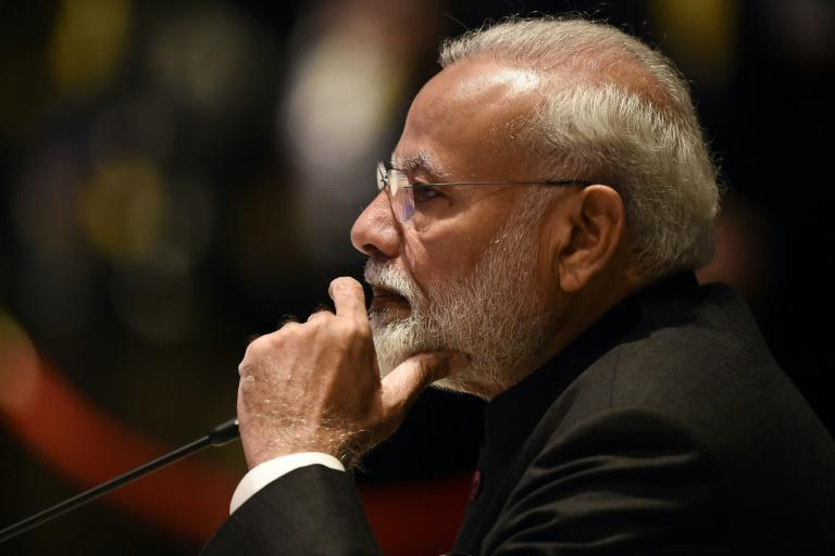 The GDP growth, now well below the level needed for India to providethe millions of jobs required each year for new entrants to the labour market, poses a major headache for Prime Minister Narendra Modi (AFP Photo/Lillian SUWANRUMPHA                )