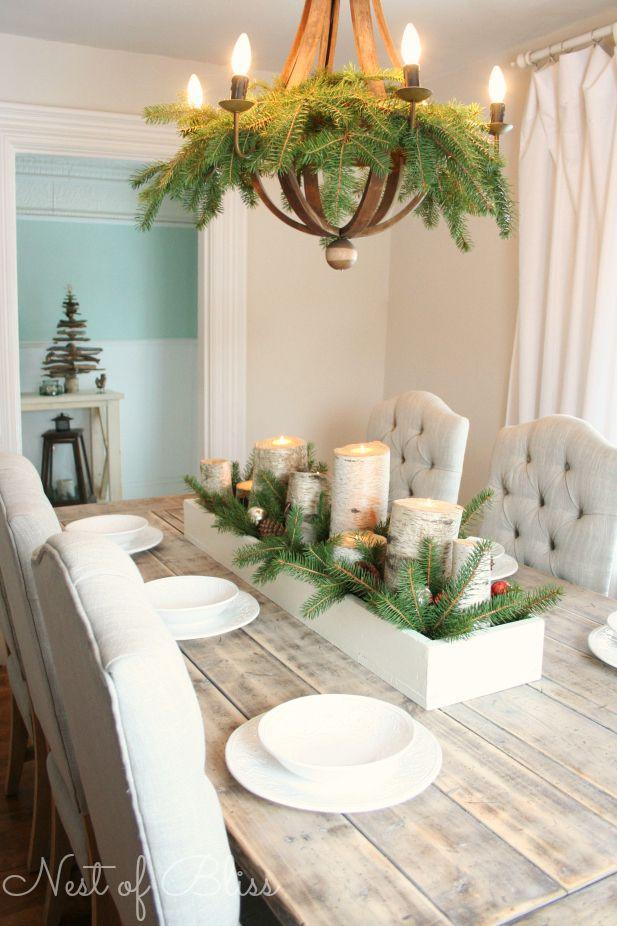 """<p>This simple setup requires just three types of pieces: birch candles, pinecones, and fresh greenery. It doesn't get much easier than that!</p><p><strong>Get the tutorial at <a href=""""http://www.brandisawyer.com/2013/12/christmas-farmhouse-tour-2013.html"""" rel=""""nofollow noopener"""" target=""""_blank"""" data-ylk=""""slk:Brandi Sawyer"""" class=""""link rapid-noclick-resp"""">Brandi Sawyer</a>.</strong></p><p><strong><a href=""""https://www.amazon.com/Koyal-Wholesale-Wedding-Decorations-Centerpieces/dp/B075RMS9M3/"""" rel=""""nofollow noopener"""" target=""""_blank"""" data-ylk=""""slk:SHOP BIRCH CANDLES"""" class=""""link rapid-noclick-resp"""">SHOP BIRCH CANDLES</a><br></strong></p>"""