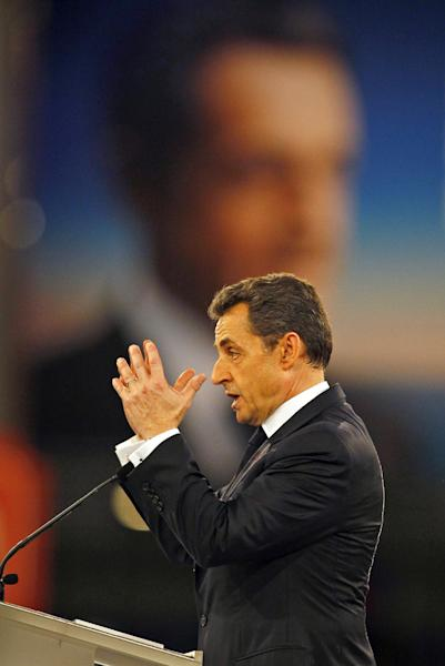 France's President and candidate for re-election, Nicolas Sarkozy delivers his speech during a meeting in Villepinte, north of Paris, France, as part of his electoral campaign, Sunday March 11, 2012. (AP Photo/Francois Mori)