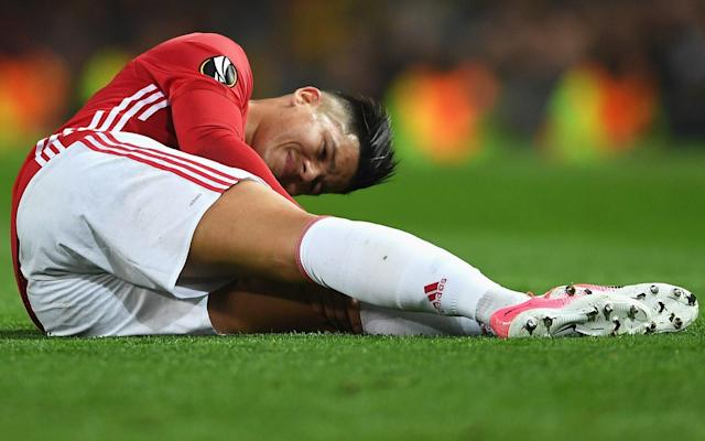 <span>Marcos Rojo is unlikely to feature for Manchester United until next season after the Argentine sustained significant knee ligament damage during his side's defeat of Anderlecht in their Europa League quarter-final second leg</span> <span>Credit:  Getty Images  </span>