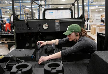 Mahindra Automotive North America assembly worker Jade Gerber assembles the pedals to a partially assembled ROXOR off-road vehicle at the MANA assembly plant in Auburn Hills, Michigan, U.S., January 30, 2019.   REUTERS/Rebecca Cook
