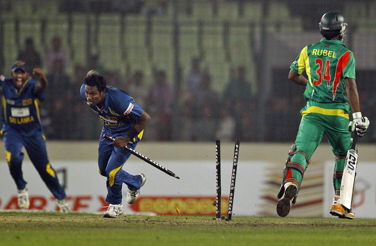 Sri Lanka's Angelo Mathews, center, celebrates after wining the first one day international cricket match against Bangladesh in Dhaka, Bangladesh, Monday, Feb. 17, 2014. Sri Lanka won by 13 runs. (AP Photo/A.M. Ahad)