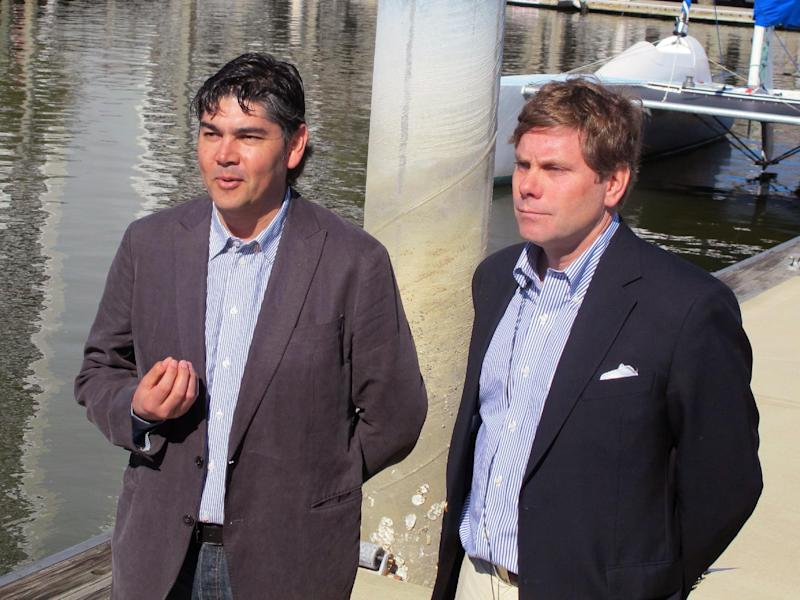 "Gustavo Gonzalez, the winemaker for Mira Winery in St. Helena, Calif., left, and winery president Jim ""Bear"" Dyke Jr., speak with reporters in Charleston, S.C., on Wednesday, Feb. 20, 2013, about the winery's experiment in wine aging. The winery on Wednesday sank four cases of wine in Charleston Harbor to see what effect the ocean has on aging the wine. Similar experiments with ocean aging have been conducted in Europe. (AP Photo/Bruce Smith)"