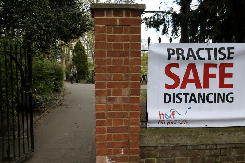 A sign is shown warning people to practise safe distancing