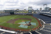 North Carolina State warms up before a baseball game playing against Vanderbilt at the College World Series Friday, June 25, 2021, at TD Ameritrade Park in Omaha, Neb. (AP Photo/Rebecca S. Gratz)