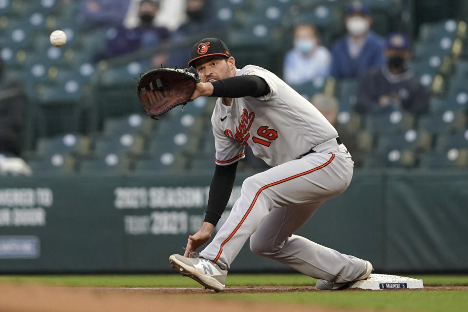 Baltimore Orioles first baseman Trey Mancini fields the ball on a ground out by Seattle Mariners' Kyle Lewis during the second inning of a baseball game, Tuesday, May 4, 2021, in Seattle. (AP Photo/Ted S. Warren)