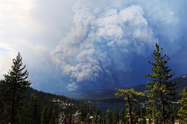 PHOTO: Huntington Lake is seen in the foreground as the Creek Fire burns in the distance, about 35 miles northeast of Fresno, California, on Sept. 5, 2020. (Eric Paul Zamora/The Fresno Bee via AP)