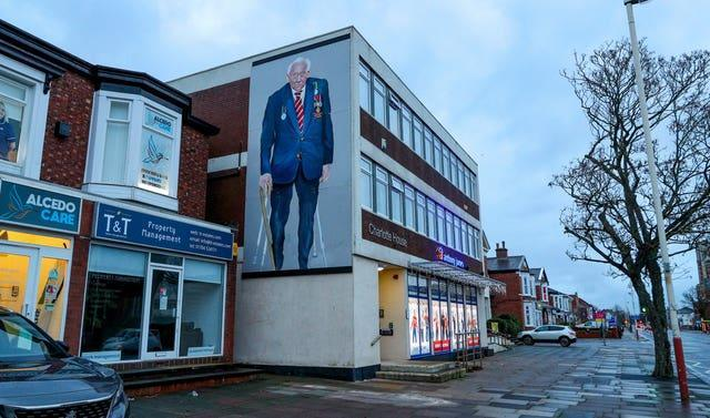 A mural of Captain Sir Tom Moore on a building in Southport (Peter Byrne/PA)