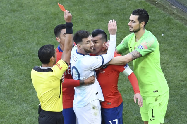 Gary Medel gets in Lionel Messi's face during the fracas that saw both players sent off. (Getty)