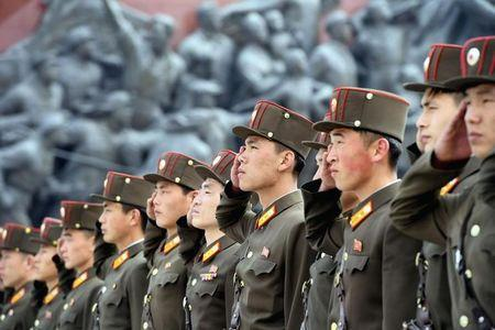 North Korean soldiers salute bronze statues (not pictured) of North Korea's late founder Kim Il-sung and late leader Kim Jong Il at Mansudae in Pyongyang, in this photo released by Kyodo April 25, 2017, to mark the 85th anniversary of the founding of the Korean People's Army. Mandatory credit Kyodo/via REUTERS/Files