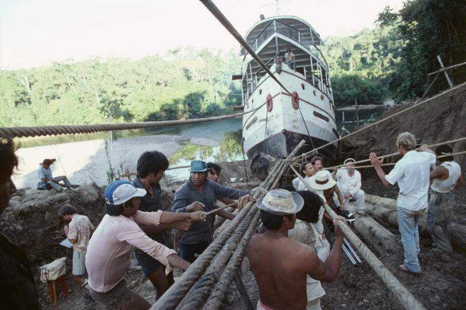 Filming on the set of Fitzcarraldo, directed by Werner Herzog, on location in Peru. Crew members hauling the paddle steamer. | Location: Peru.  (Photo by jean-Louis Atlan/Sygma via Getty Images)
