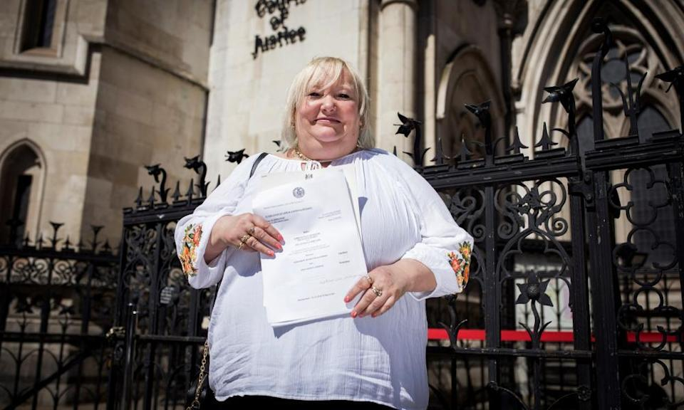 Della Robinson, 53, outside the Royal Courts of Justice, London.