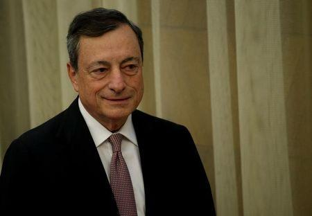 European Central Bank President Draghi stands before delivering his speech during an event at Bank of Spain headquarters in Madrid