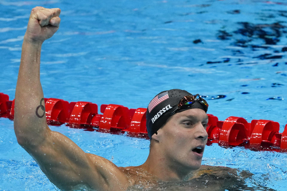 Caeleb Dressel, of United States, celebrates winning the gold medal the men's 50-meter freestyle final at the 2020 Summer Olympics, Sunday, Aug. 1, 2021, in Tokyo, Japan. (AP Photo/Jae C. Hong)