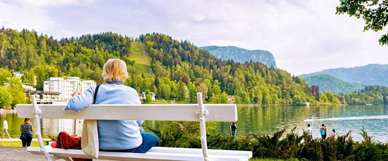 Woman sitting on the bench at Bled Lake, Slovenia