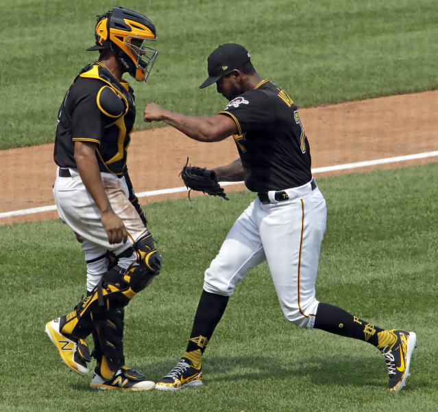 Pittsburgh Pirates relief pitcher Felipe Vazquez, right, celebrates with catcher Elias Diaz after getting the final out in their 2-1 win over the Milwaukee Brewers in the first baseball game of a doubleheader in Pittsburgh, Saturday, July 14, 2018. (AP Photo/Gene J. Puskar)