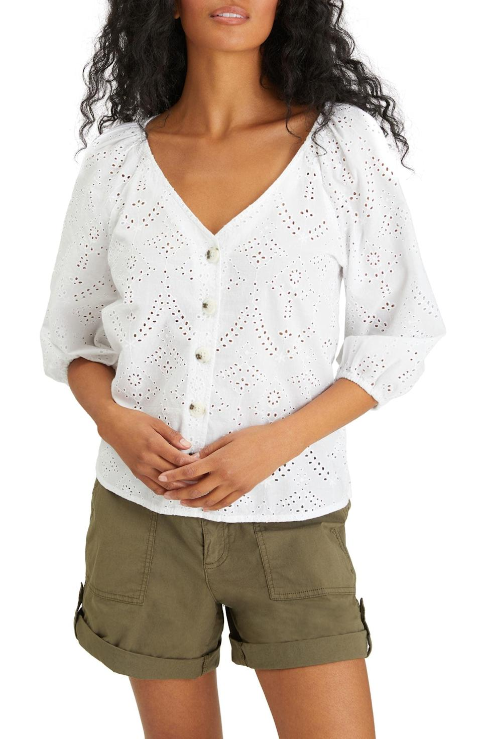 <p>Head to the beach in this stylish and easygoing <span>Sanctuary Modern Eyelet V-Neck Blouse</span> ($99).</p>