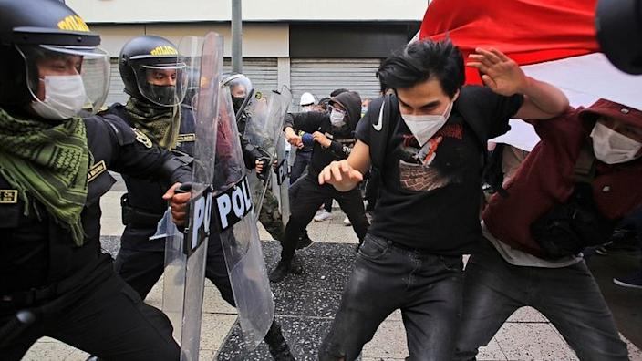 Demonstrators clash with police during a protest in Lima, Peru, on 10 November 2020