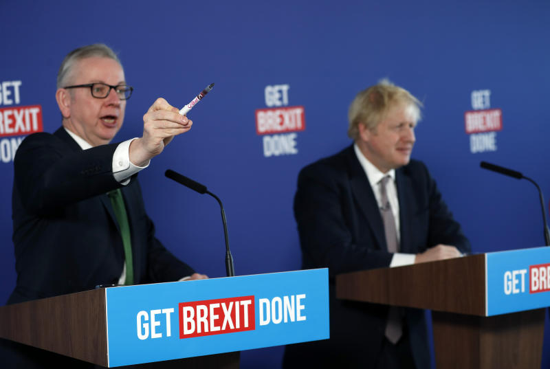 Chancellor of the Duchy of Lancaster Michael Gove, left, and Britain's Prime Minister Boris Johnson attend a media conference in London, Friday, Nov. 29, 2019. Britain goes to the polls on Dec. 12. (AP Photo/Frank Augstein)