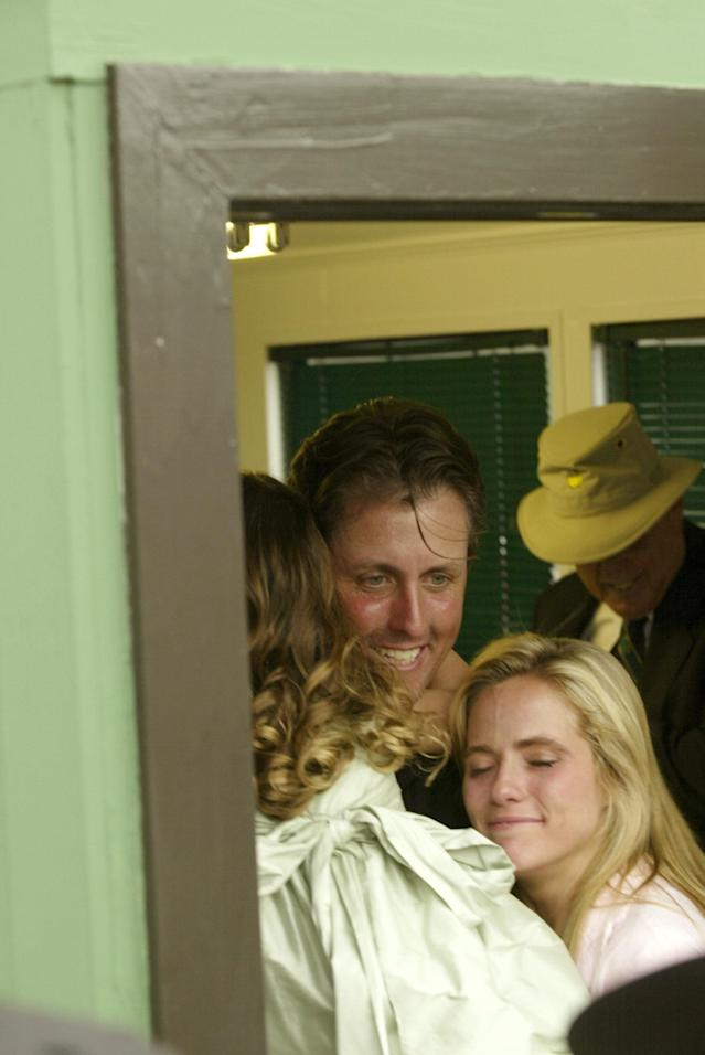 """<h1 class=""""title"""">2004 Masters - Final Round</h1> <div class=""""caption""""> Phil and Amy Mickelson celebrate with daughter Amanda </div> <cite class=""""credit"""">Robert Beck</cite>"""