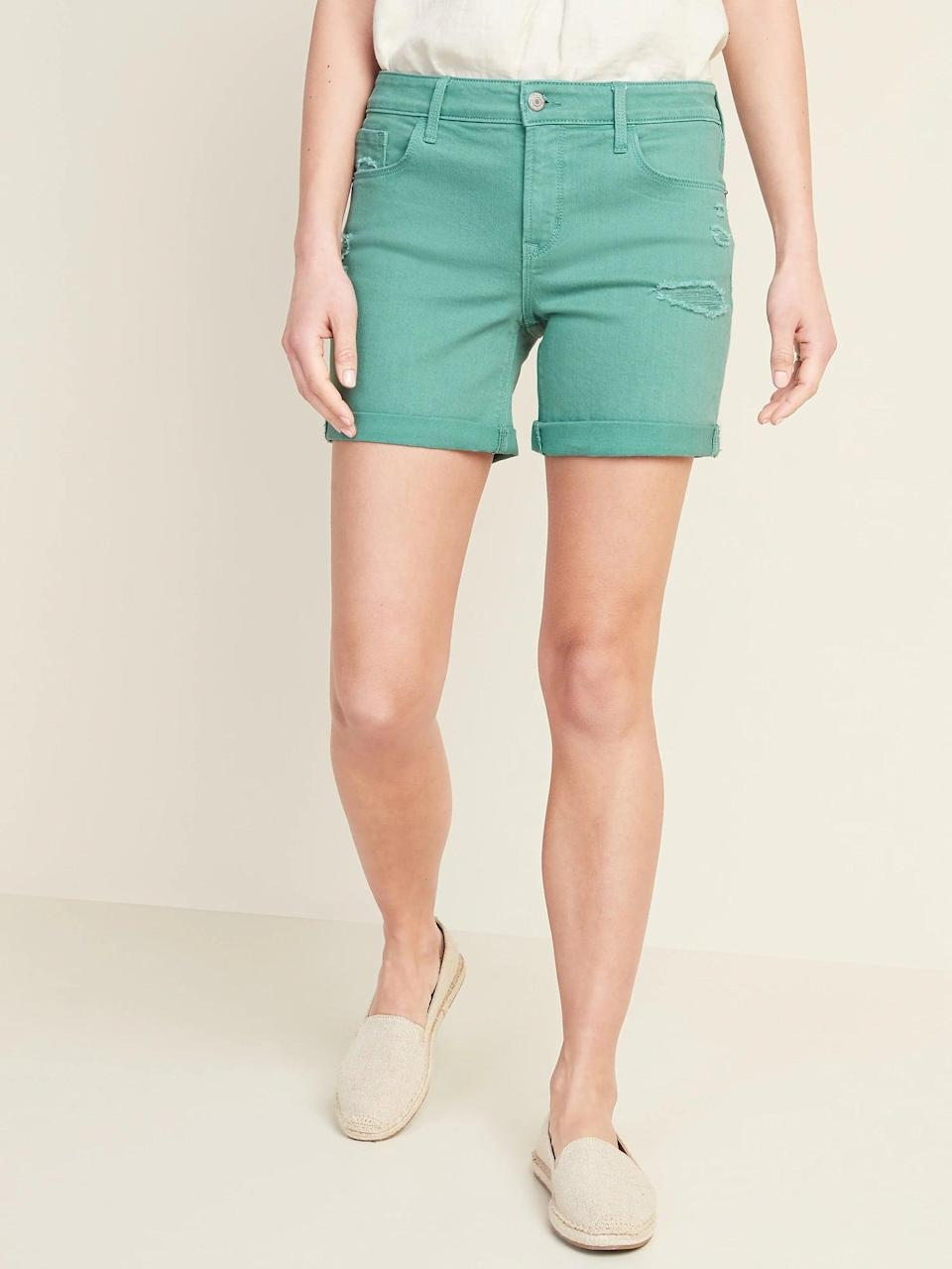 <p>Slip on the cuffed <span>Old Navy Mid-Rise Distressed Green-Color Jean Shorts</span> ($12, originally $30) with a flowy printed top, or tuck in something neutral instead.</p>