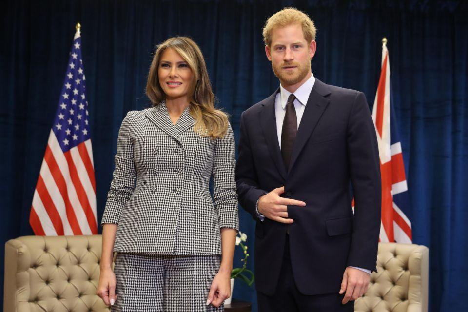 What is Prince Harry doing with his hand while meeting Melania Trump? Photo: Getty