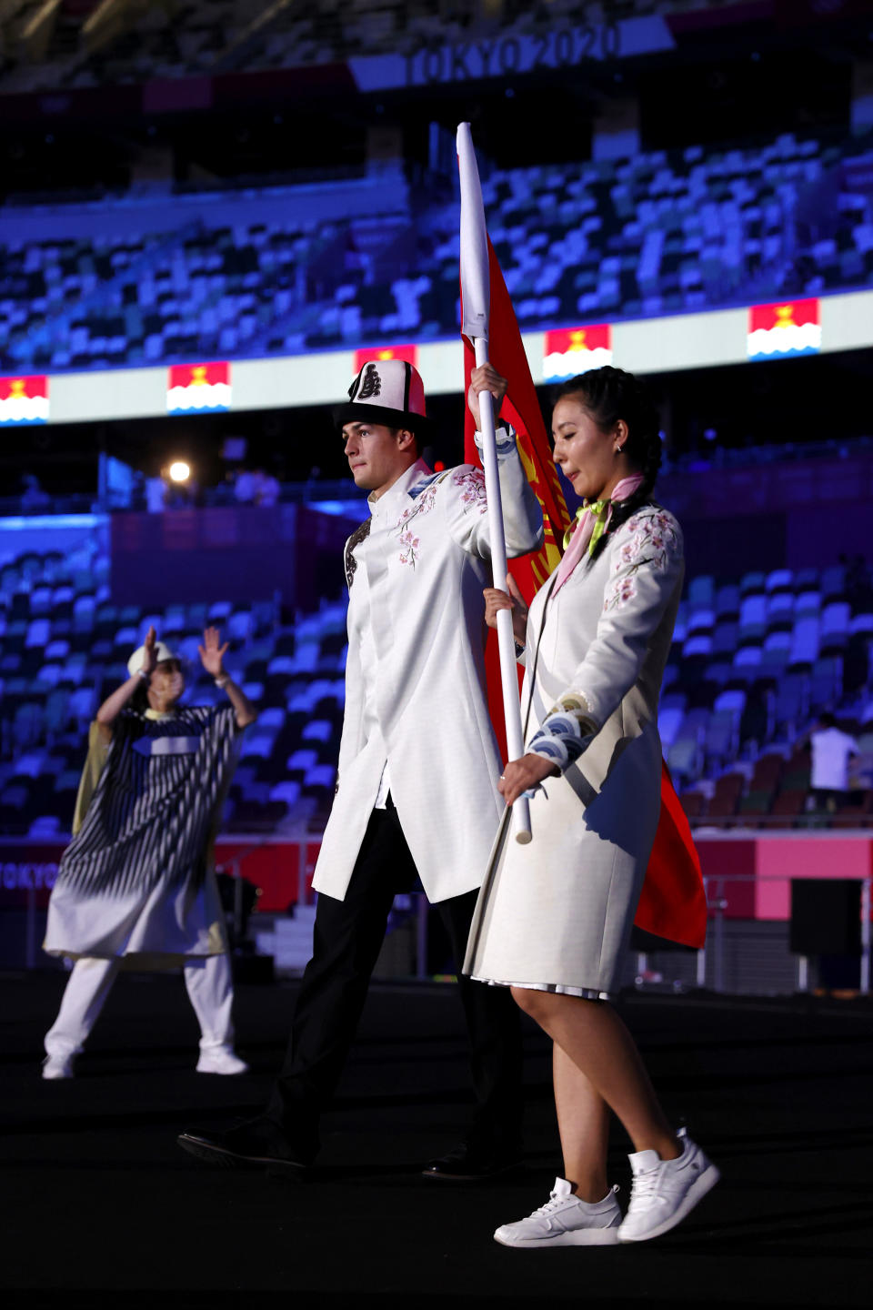 TOKYO, JAPAN - JULY 23: Flag bearers Kanykei Kubanychbekova and Denis Petrashov of Team Kyrgyzstan during the Opening Ceremony of the Tokyo 2020 Olympic Games at Olympic Stadium on July 23, 2021 in Tokyo, Japan. (Photo by Jamie Squire/Getty Images)
