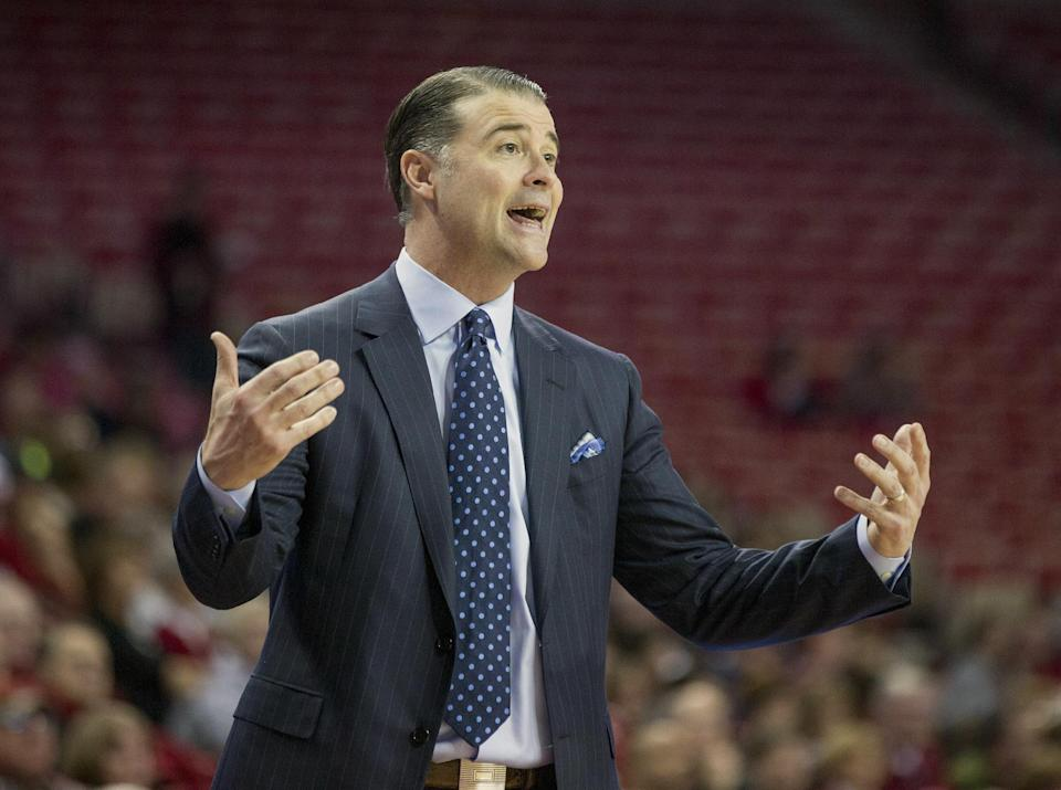 Kentucky head coach Matthew Mitchell reacts to a foul call during the first half of an NCAA college basketball game against Arkansas, Thursday, Feb. 26, 2015, in Fayetteville, Ark. (AP Photo/Gareth Patterson)