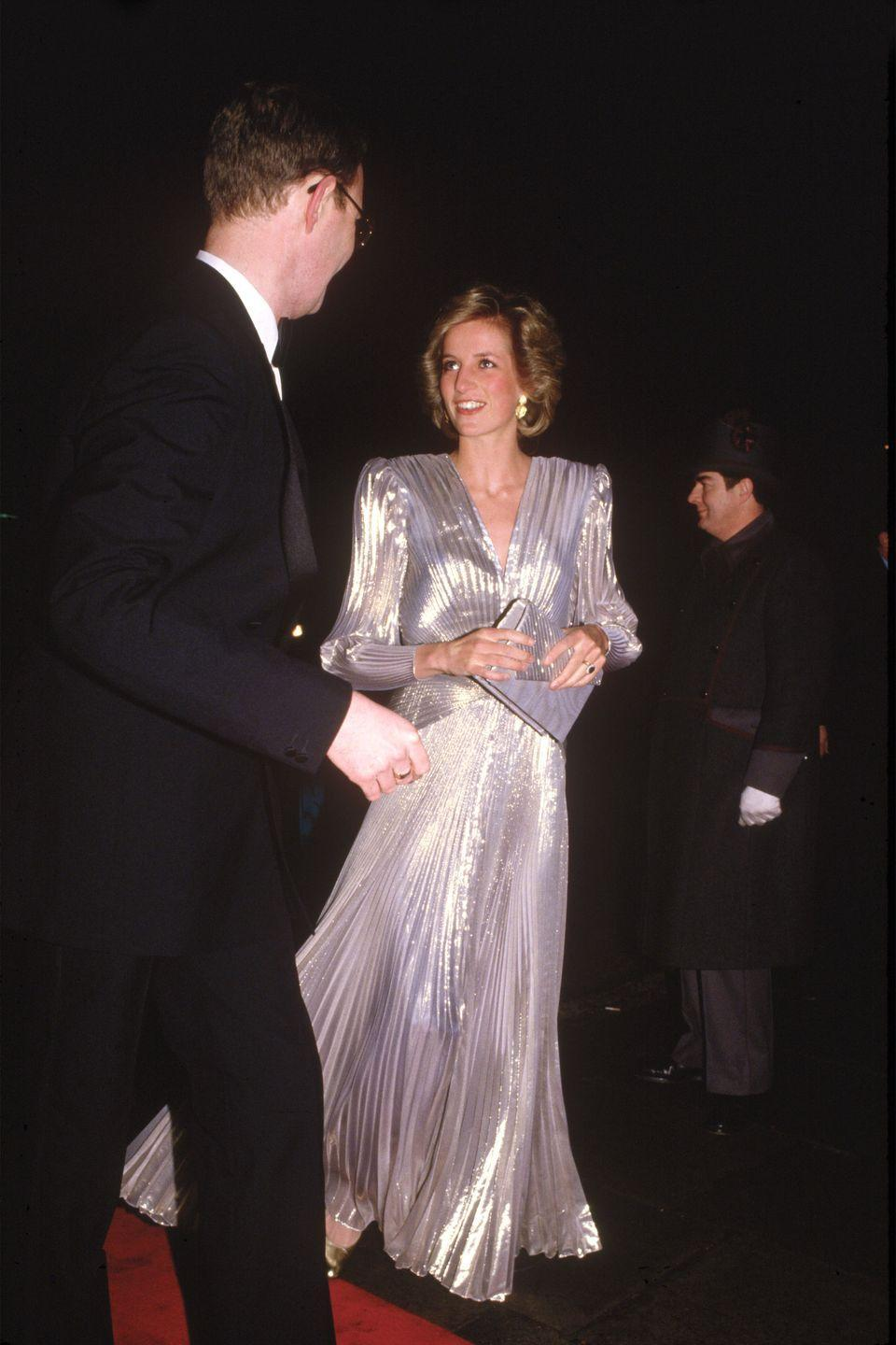 <p>In a metallic dress by Bruce Oldfield arriving at a fashion show at Grosvenor House Hotel in London.</p>