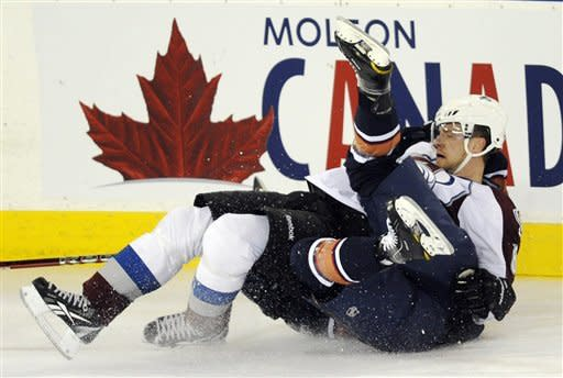 Edmonton Oilers' Ben Eager, right, collides with Colorado Avalanche Jan Hejda during the first period of an NHL hockey game, Tuesday, Jan. 31, 2012, in Edmonton, Alberta. (AP Photo/The Canadian Press, John Ulan)