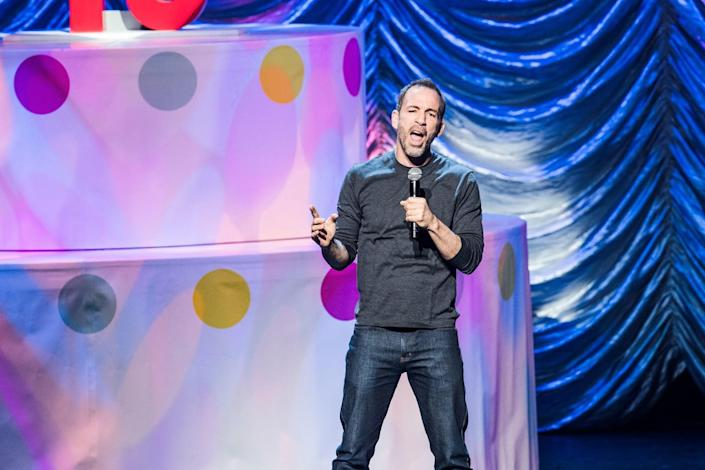 """Bryan Callen performs at KROQ's """"Kevin & Bean's April Foolishness"""" in 2018. <span class=""""copyright"""">(Timothy Norris / Getty Images)</span>"""