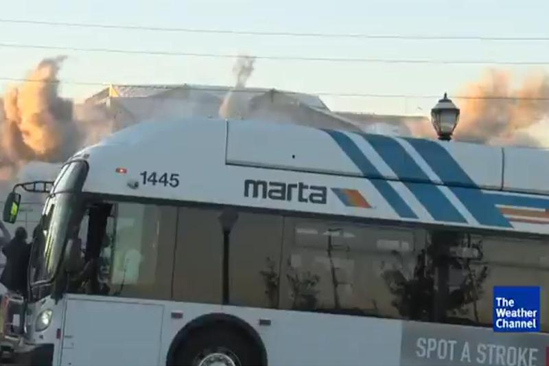 Unfortunate timing: the moment a bus pulled in front of the camera just as the explosions began