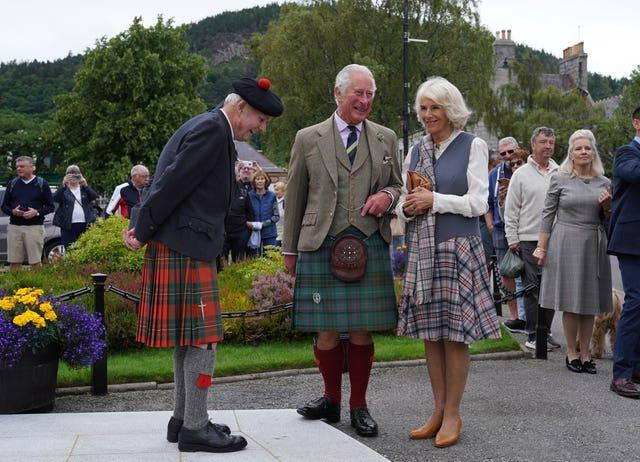 Prince of Wales and the Duchess of Cornwall chat with Hugh Inkster