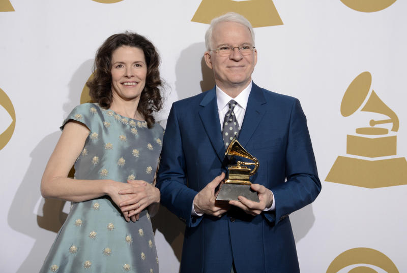 "Edie Brickell, left, and Steve Martin pose in the press room with the award for best American roots song, ""Love Has Come For You,"" at the 56th annual Grammy Awards at Staples Center on Sunday, Jan. 26, 2014, in Los Angeles. (Photo by Dan Steinberg/Invision/AP)"