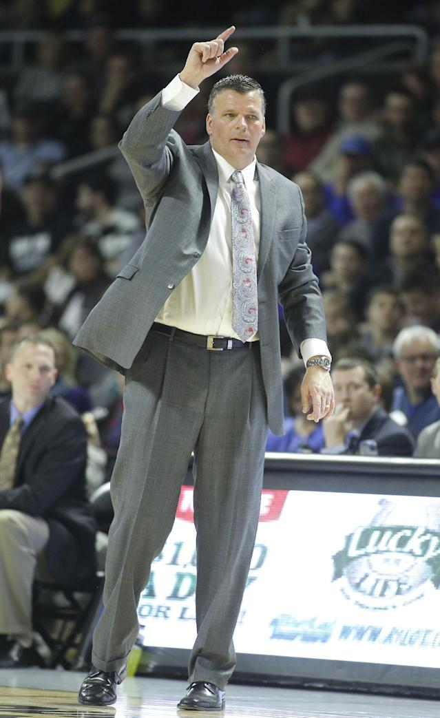 Creighton head coach Greg McDermott gestures during the first half of an NCAA college basketball game against Providence, Saturday, Jan. 18, 2014, in Providence, R.I. (AP Photo/Stew Milne)