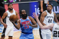 Brooklyn Nets' James Harden (13) looks to pass away from San Antonio Spurs' Rudy Gay (22) during the second half of an NBA basketball game Wednesday, May 12, 2021, in New York. (AP Photo/Frank Franklin II)