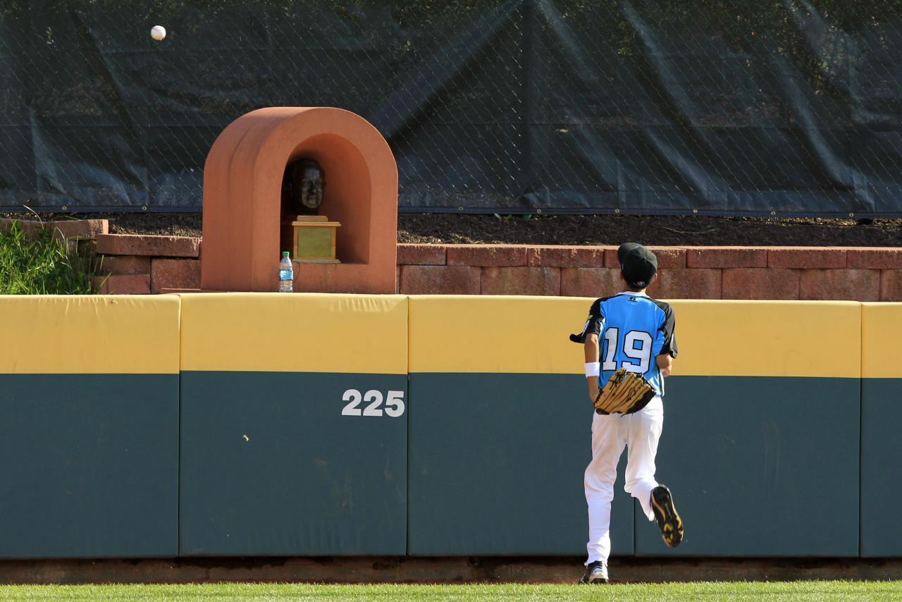Goodlettsville, Tenn., center fielder Jayson Brown (19) watches as the game-winning, two-run home run by Tokyo, Japan's Noriatsu Osaka lands over the wall in the fifth inning of the Little League World Series championship baseball game in South Williamsport, Pa., Sunday, Aug. 26, 2012. Tokyo won 12-2. (AP Photo/Gene J. Puskar)