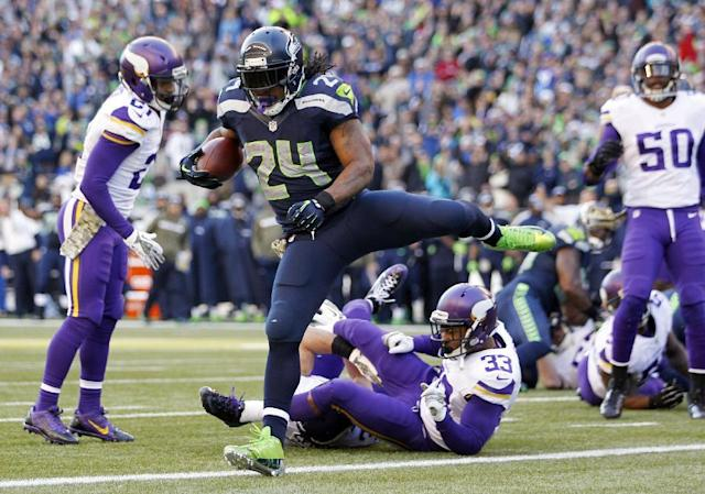 Seattle Seahawks' Marshawn Lynch (24) scores against Minnesota Vikings in the first half of an NFL football game Sunday, Nov. 17, 2013, in Seattle. (AP Photo/John Froschauer)