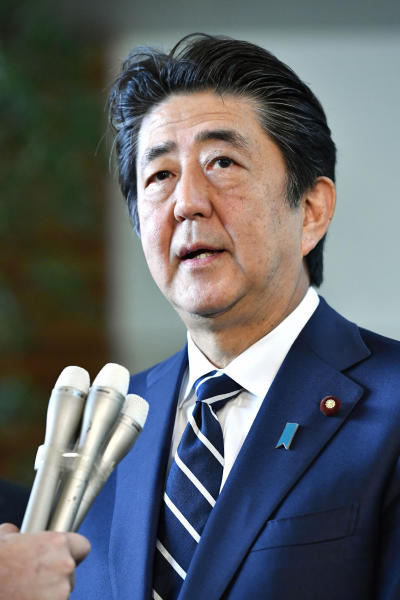Japanese Prime Minister Shinzo Abe speaks to reporters at his official residence in Tokyo Friday, Aug. 23, 2019. Abe said South Korea's decision to cancel a deal to share military intelligence is damaging mutual trust, and he vowed to work closely with the U.S. for regional peace. Abe also accused Seoul of not keeping past promises. The military agreement started in 2016. (Yoshitaka Sugawara/Kyodo News via AP)