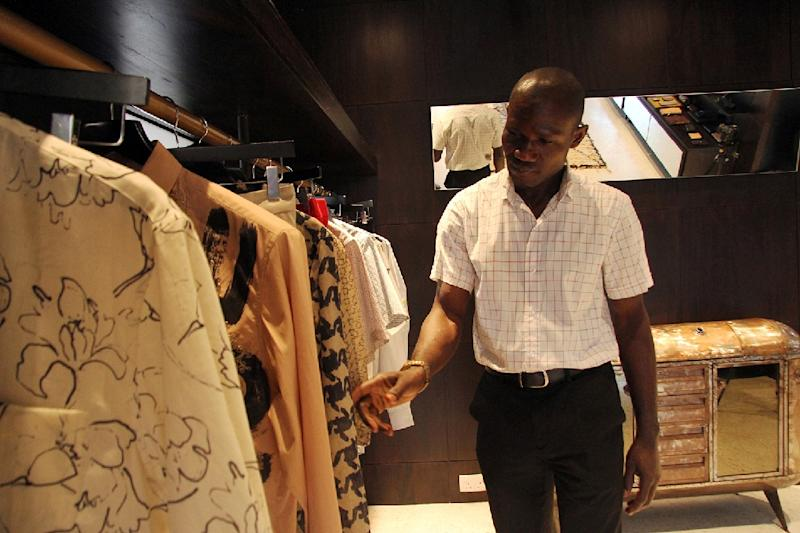 A customer checks our clothes at Alara, a new retail concept store on Victoria Island in Lagos (AFP Photo/Emmanuel Arewa)