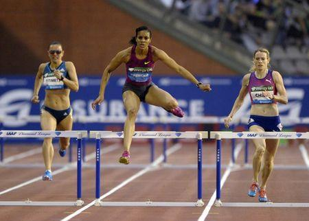 Kaliese Spencer (C) of Jamaica wins the women's 400 metres hurdles during the IAAF Diamond League athletics meet, also known as Memorial Van Damme, in Brussels September 5, 2014. REUTERS/Laurent Dubrule